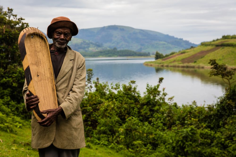 Eric Mazimwe, 91, a player of enanga, on Habukomi Island; photo by Marcus Westberg