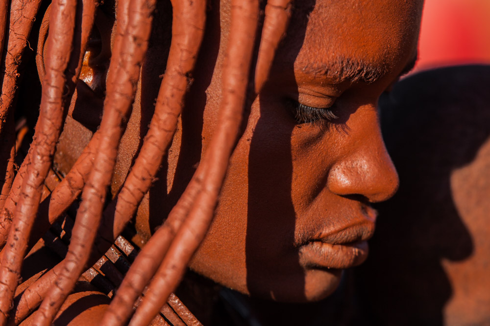 A Himba girl in northern Namibia, her skin covered with a mixture of ochre and butter fat; photo by Marcus Westberg