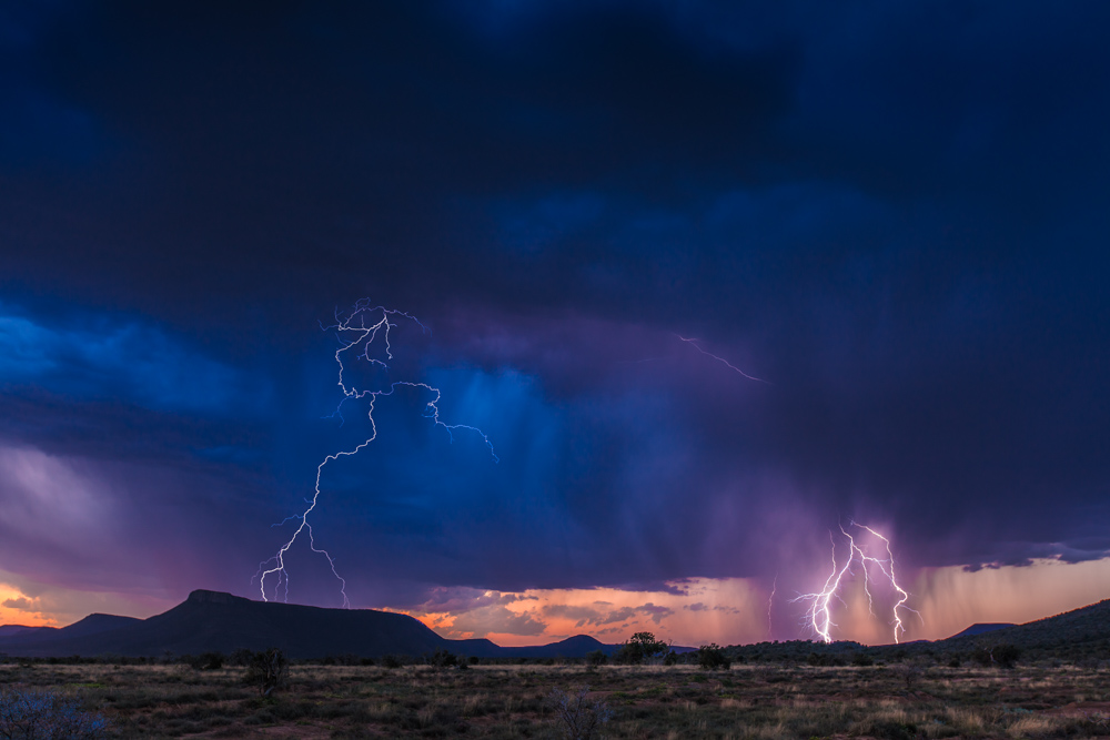 A thunderstorm rolls in over the normally arid Karoo, South Africa; photo by Marcus Westberg