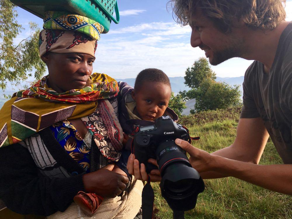 Marcus Westberg taking portraits in Rwanda; photo by Miha Logar
