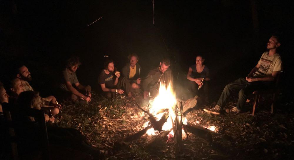 Hank Rugg sharing a story at a campfire; photo by Miha Logar