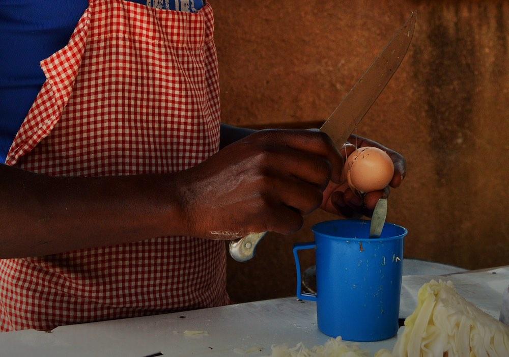 Rolex recipe - cutting eggs; photo by Rachel Peet