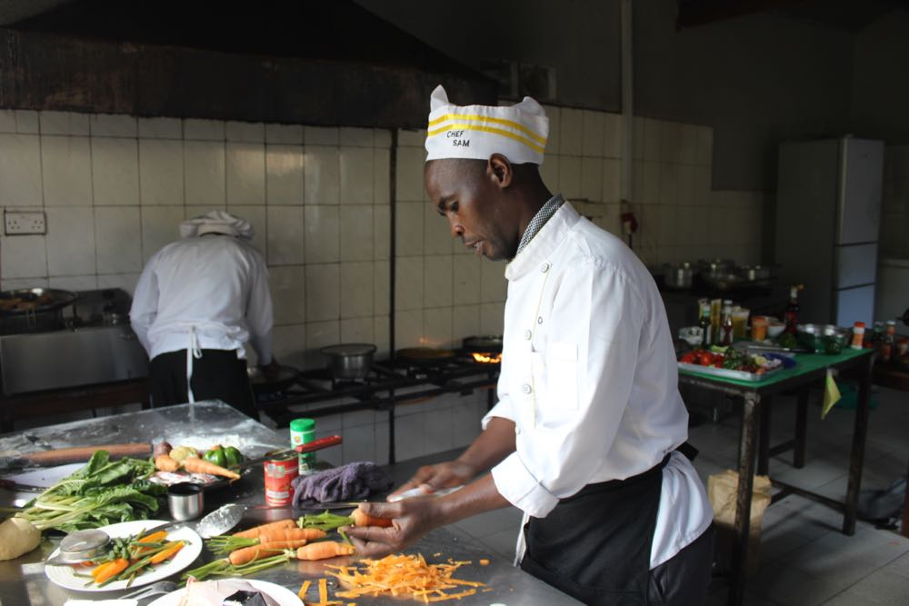 Bunyonyi Overland's competitor, Sam Agaba, starting to cook; photo by Abby Bluth