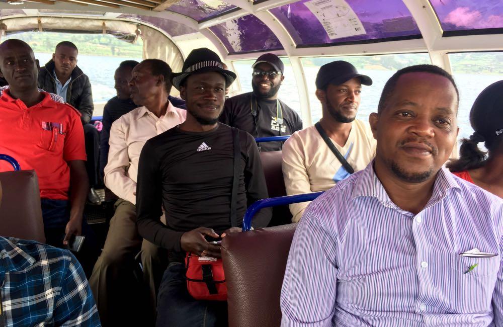 Davidson Mugisha (front) during the Lake Bunyonyi boat ride; photo by Miha Logar
