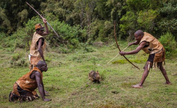 Batwa hunters with their dog during the Batwa Trail in Mgahinga Gorilla National Park; photo by Marcus Westberg