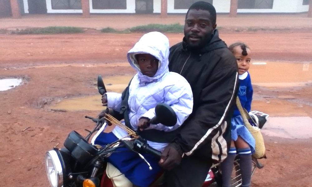 Enya going to school by boda