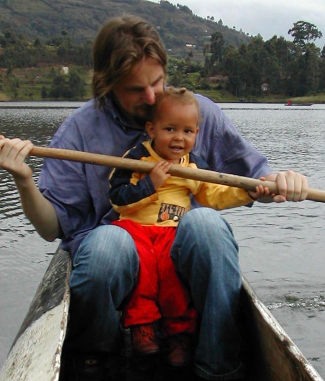 Enya with her dad on Lake Bunyonyi in 2006