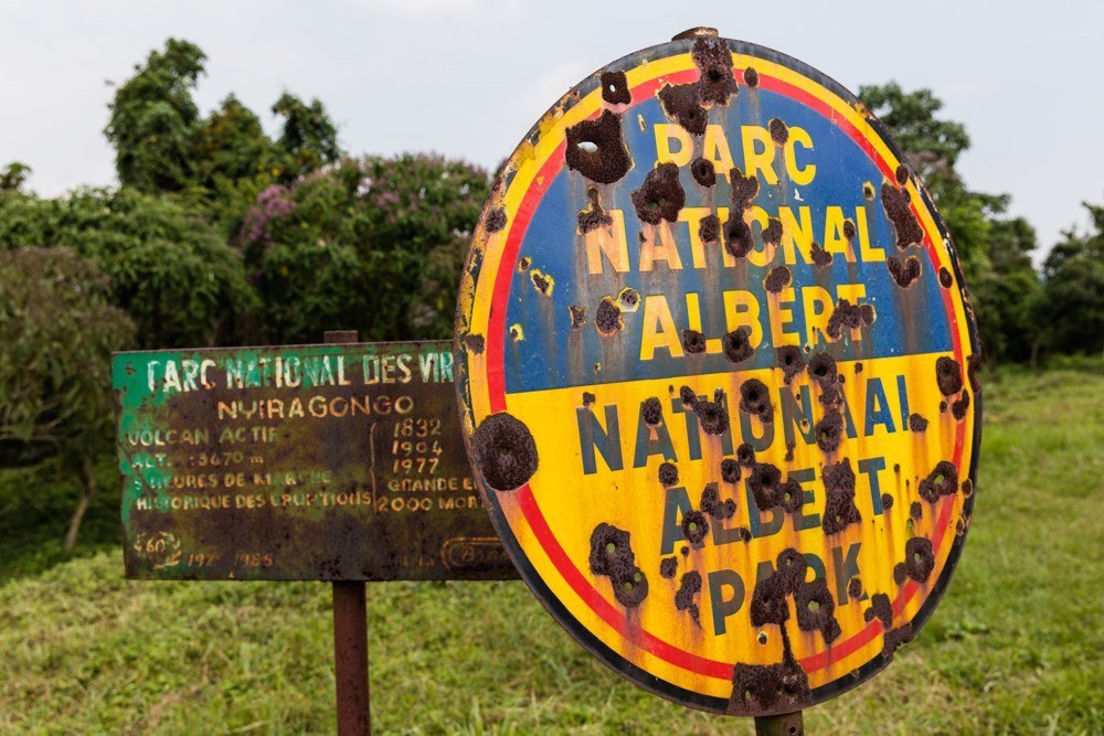 Old and new Virunga National Park signpost