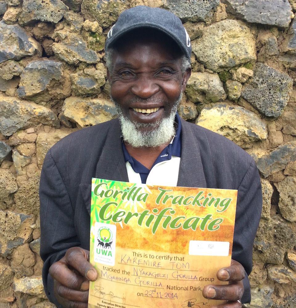 Tom Karemire with his gorilla certificate