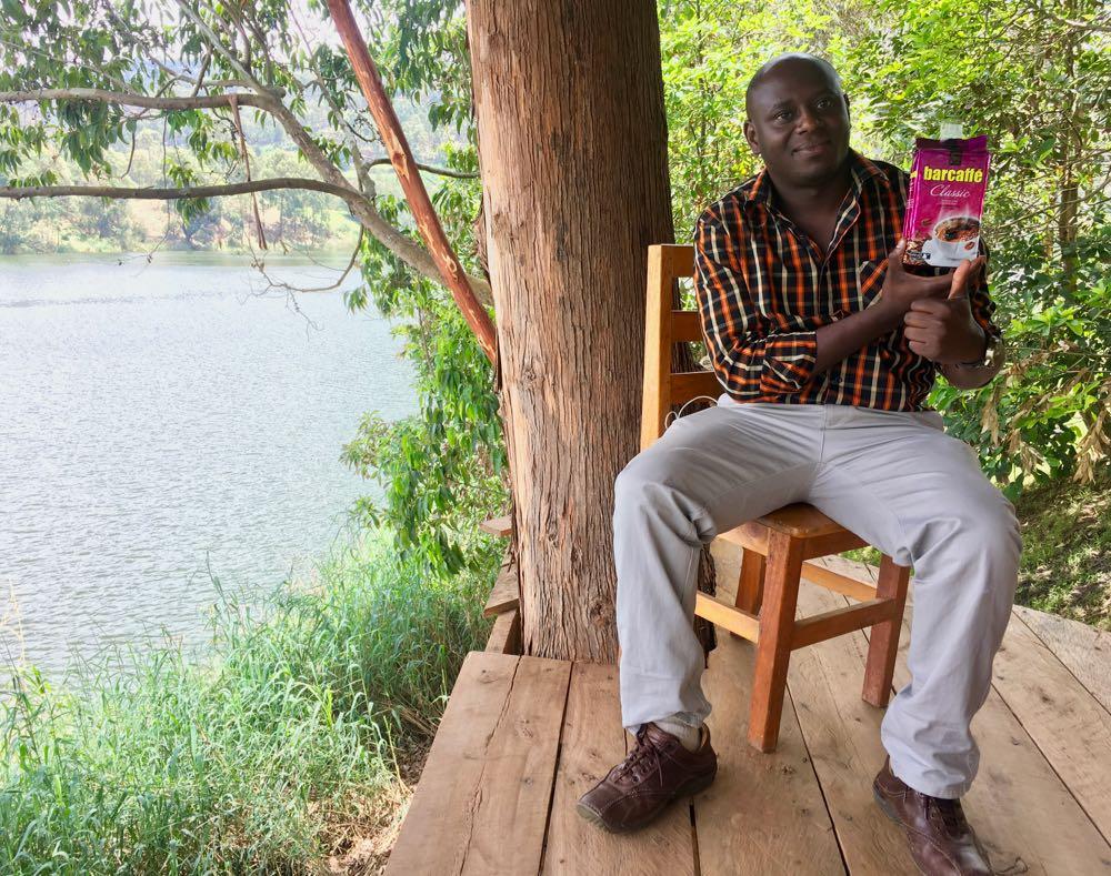 Julius Wetala of Coffee Tours on the Edirisa tree house platform; photo by Miha Logar