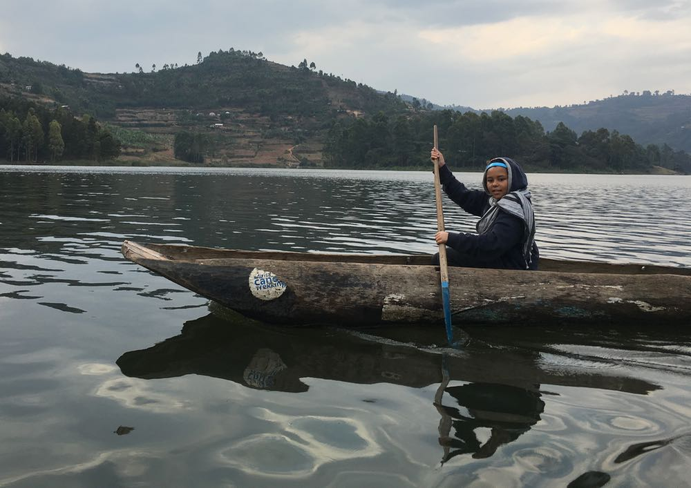 Enya canoeing to Bushara Island; photo by Miha Logar