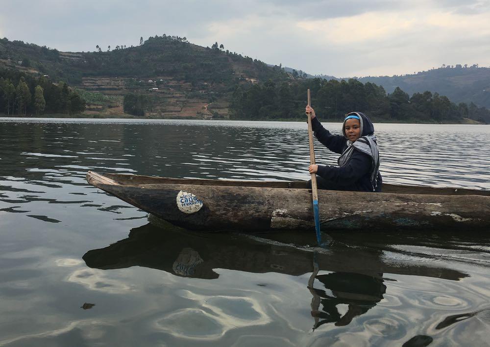 Enya canoeing to Bushara Island; photo by Miha Logar