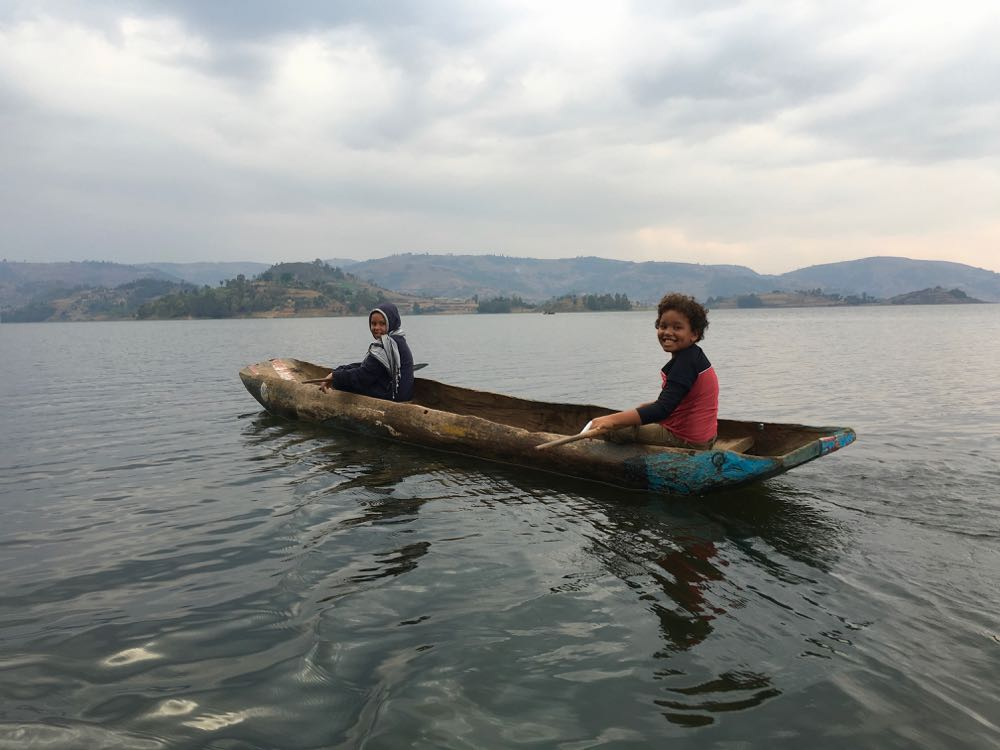Enyanja Kanyunyuzi Logar and Maani Logar canoeing on Lake Bunyonyi; photo by Miha Logar