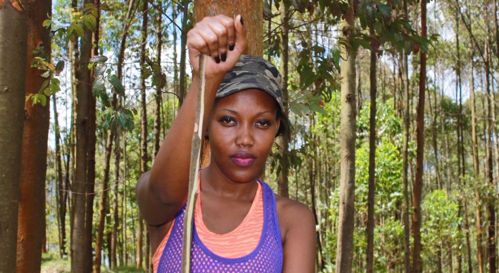 Isabelle Lydia Masozera taps into her Masozeraness on the slopes above Lake Bunyonyi; photo by Enock Luyonza